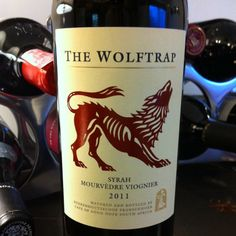 Boekenhoutskloof The Wolftrap 2011.  Syrah, Mourvèdre, & Viognier.  A really pleasant South African red blend for under $15.00.  Oh, and I think the label is awesome!