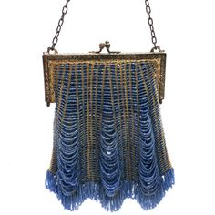 Lovely vintage purse of wheat colored micro-crochet with oodles of cornflower blue glass beads woven into and around the handbag. It is lined in silk, and there is a tiny break in the bottom seam of t