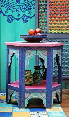Here, Janice has used Provence as a backdrop, and has stencilled a mandala shape onto the wall using Napoleonic Blue. On the tiles on the floor, she used Provence, Napoleonic Blue, Old White and Arles. The Moroccan-style side table features Henrietta, Provence, Napoleonic Blue and English Yellow, and the screen is Old Violet, Barcelona Orange, Emperor's Silk and English Yellow. The furniture has been finished in my Soft Clear Wax.