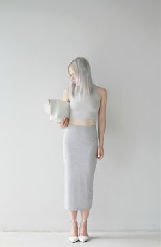 This Grey Monochrome picture... her grey hair... grey crop top and high waist pencil skirt plus white shoes and bag to match...! wow