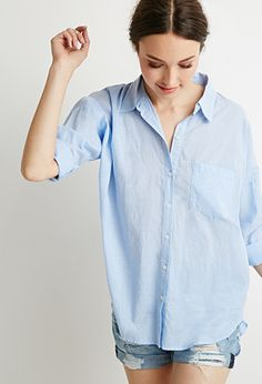 Oversized button downs are cool and crisp for spring days. #babyblue