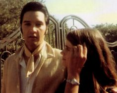 {*Elvis at his 1174 Hillcrest Rd, Beverly Hills home with a fan at the Gates*}