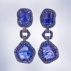 Tantalising Tumbled Tanzanites Deep blue in hue I decided to surround them with sapphires and was thrilled with the result. No diamonds - just this strong pop of blue. #australiandesigner #margotmckinneyjewellery #neimanmarcus #oneofakindjewelry #luxuryjewelry #hautejoaillerie #tanzanite #earrings #sapphire
