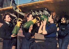 WRENs fitting smoke floats to a Swordfish aircraft, 1943