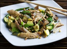 wok with chicken, shallots, zucchini, green beans, pine nuts and avocado.