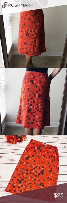 Free People Flower Skirt Super cute skirt with flowers. Skirt is silky and really light. There is little stain on back you can see in photo.  • 100% polyester. • Size zipper.  • Hand wash.  • Measurements approx: wait 30in; hips 42; length 27in. •  Labeled as 7/8 size. Free People Skirts Midi