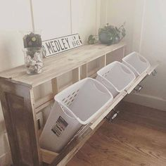 Chic way to have a recycling bins in the house in a stylish cabinet made of pallets