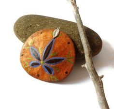 Painted sand dollar pendant with silver leaf by CrowsdanceDesigns,