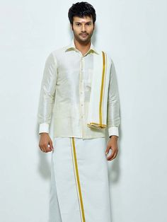 Prodigious white color raw silk shirt comes with cotton dhoti and angavastram. Item Code : SCU13609 http://www.bharatplaza.com/new-arrivals/south-indian-mens-wear.html