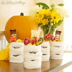 I have the cans--this is an easy holder for my snacks for the party!!!!  Yay!   Halloween Craft Ideas | Mummy Cans | The Lettered Cottage