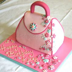 Flowery Handbag Cake Shaped sponge cake, modelled handle and flowers Handbag cakes serve from depending on size Más Fondant Cakes, Cupcake Cakes, Fondant Girl, Fondant Bow, Fondant Tutorial, Fondant Flowers, Fondant Figures, Girly Cakes, Fancy Cakes