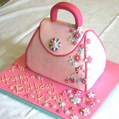 Flowery Handbag Cake    Shaped sponge cake, modelled handle and flowers    Handbag cakes serve from 20, depending on size