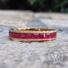 Custom crafted by Sara and Daniel at our workshop in Weiss Jewelry in Los Angeles: 14k Yellow Gold eternity band, with princess cut Rubies a glorious milligrained and beautifully hand engraved band. #handmade #handcrafted #handfinished #handset #engraved #handengraved #weissjewelry #ring #eternityband #finejewelrydesigner #microsetting #engraving #wedding #weddingring #14K #gold #jewelry #customcrafted #losangeles #madetoorder #saraweiss #danielweiss #farmersmarketla #madeinla…