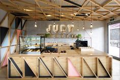 Jury Cafe by Biasol Design Studio. It features very nice geometric patterns and a lot of light-natural coloured wood.