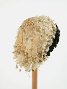 Lace cap with pearls 1880