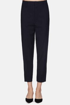 Tailored trousers in a crisp blue—between navy and midnight—that pair beautifully with virtually any top or jacket. The secret behind the clean…