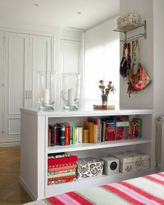 room divider...use cloth covered boxes on shelves for storage.