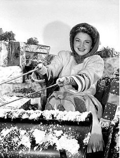 Anne Baxter, 1943,  Christmas during WW2 - she thinks each of us should give Santa a hand by carrying home as many packages as we can.