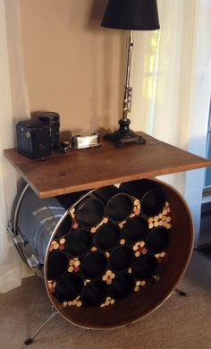 Bass drum wine rack table...a wine lovers dream.  Www.musicasartbysarah.etsy.com