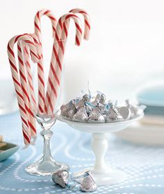 Something as simple as glasses and dishes filled with seasonally appropriate candies can make a sweet table topper, especially at dessert time. Here, classic candy canes pair with chocolates wrapped in tinsel-colored foil. Simple Christmas, All Things Christmas, White Christmas, Christmas Holidays, 1st Christmas, Christmas Candy, Christmas Wedding, Winter Holidays, Christmas Ideas