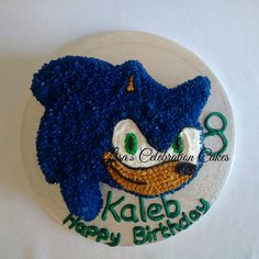 """Sonic 8"""" cake all decorated in buttercream."""