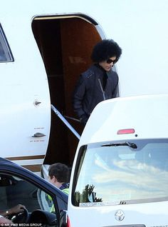 Rare photo of Prince getting out of his private jet 2015.