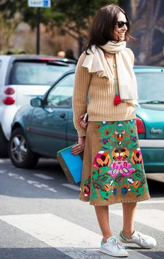 Camel sweater, print skirt and sneakers.