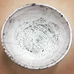 Ceramic, wheel thrown, raku, white crackle glaze bowl.
