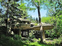 """Located in the woods in upstate New York, the whimsical Mushroom House (above) features five, interconnected """"pods"""" in the shape of mushrooms. Who would want to live in a traditional home when you can live in a mushroom? It is still for sale for $799,900."""