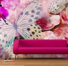 Cool pink couch and butterfly painted wall