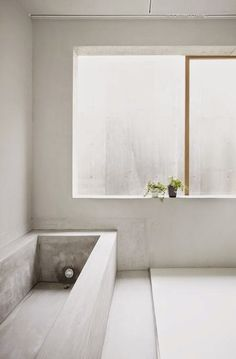 with a natural touch Minimalistic bathroom with concrete bathtub by Suppose Design OfficeMinimalistic bathroom with concrete bathtub by Suppose Design Office Minimalist Bathroom, Modern Bathroom, White Bathrooms, Luxury Bathrooms, Master Bathrooms, Dream Bathrooms, Contemporary Bathrooms, Modern Minimalist, Concrete Bathtub
