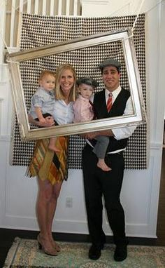 DIY party photo booth:  I think this is very cute.  Id add a larger back drop behind the black and white so the wall, wall socket, steps, stair rail are hidden.