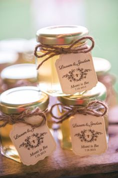 super cute jars of honey as wedding favors for the guests #weddingfavor #honey #weddingchicks http://www.weddingchicks.com/2014/01/24/pinterest-inspired-vintage-wedding/