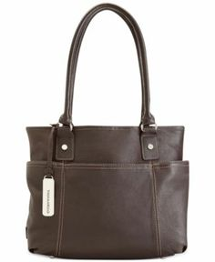 """This tote has a snap closure. The double handle has a drop of 9.5? Exterior has 4 slide-in pouches. Interior is fully lined with a center zipper compartment, a zipper pocket on back wall, and 2 media pouches. Dimensions: L 11"""" x W 3.25"""" x H 11""""."""