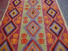 Look at these colors! Purple, mint, red, orange, magenta.  This guy has some of the best kilims on ebay.  I only wish I had more floors. $159