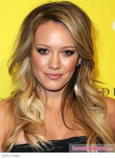 Hilary Duff hit the town with loose pretty waves worn casually flung across the shoulders. The off-center part give way to shapely waves that cascade around the face.