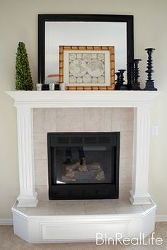 layering mirror and picture over fireplace mantle