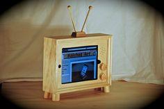 "The retro style ""iPad TV"" custom handmade wooden docking stand for iPad 1, 2, 3 and 4. $95.00, via Etsy."