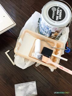 Supplies need to paint thermofoil cabinets. A sanding block, paint tray, paint brush, foam roller, foam brush and Zinsser primer. Painting Laminate Kitchen Cabinets, Melamine Cabinets, Mdf Cabinets, Maple Cabinets, New Kitchen Cabinets, Wood Laminate, Painting Cabinets, Diy Kitchen Remodel, Condo Kitchen