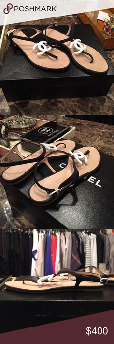 Chanel sandals, black with white enamel emblem. Beautiful sandals! Worn outside once, excellent condition. I do not have the original box but can send in a different Chanel box per request. CHANEL Shoes Sandals