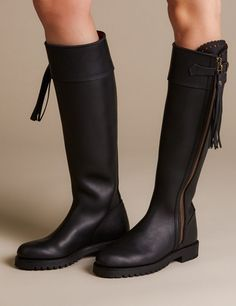 The original Penelope Chilvers Long Tassel Boot in Spanish vegetable-dyed leather. This handmade boot is cut close to the ankle for a more feminine fit, has a scalloped detail at the zip panel and a leather tassel on the zip pull. It is fully leather lined and has a Goodyear Welted Commando rubber sole. Perfectly styled for long slim legs, our Long Tassel Boots as worn by the Duchess of Cambridge encase the leg beautifully giving a sleek elegant silhouette. (CALF MEASUREMENTS, circumference…
