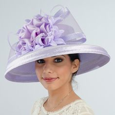 The elegant polystraw hat is adorned with a taffeta ribbon flower backed by…