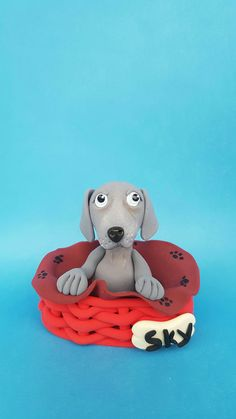 """Are you looking for a topper that features your favourite animal? This eye-catching and original Weimaraner cake topper will give your cake a quirky wow factor with this cute. So really there' s no excuse not to have it, right? Choose name of your pet on bone. Beautiful decoration on your dog birthday cake or figurine for collectors...it is a perfect keepsake gift. Material: High quality and special non-toxic polymer clay. They last a lifetime. Dimensions: 2,7"""" x 2,3"""" (7 x 6 cm) Dog Cake Topper, Cake Toppers, Dog Birthday, Birthday Cake, Red Basket, Polymer Clay Cake, Beautiful Decoration, Weimaraner, Etsy Seller"""