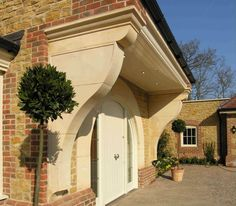 Large Bath stone corbels and stone entrance arch. Templestone.co.uk.