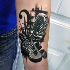 Charcoal Black Guitar And Microphone Tattoo Male Forearms