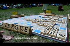 Reception Activities Yard Games: Oversized Board Games And if you're feeling more adventurous, you can even create a jumbo Scrabble board by painting letters on wooden blocks and drawing the board on a drop cloth. Outdoor Wedding Games, Wedding Reception Activities, Wedding Games For Guests, Reception Ideas, Wedding Receptions, Wedding Yard Games, Outdoor Parties, Reception Decorations, Board Game Wedding