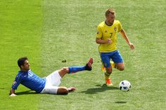 Eder of Italy tackles Sebastian Larsson of Sweden during the UEFA EURO 2016 Group E match between Italy and Sweden at Stadium Municipal on June 17, 2016 in Toulouse, France.