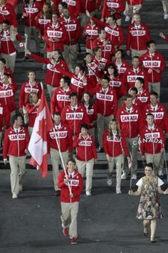 The Canadian Olympic team marches into the opening ceremony behind flag bearer Simon Whitfield at the 2012 London Olympics, on Friday, July 27, 2012.  COC photo by Mike Ridewood