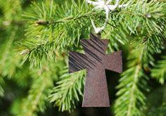 A rustic brown powdercoated metal cross Christmas tree ornament.