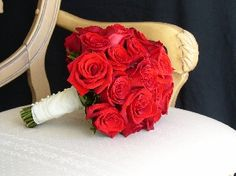 Classic red rose hand tied with pearl accented stem wrap
